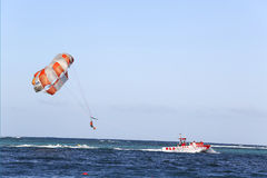 Parasailing in a blue sky in Punta Cana, Dominican Republic stock photography