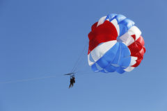 Parasailing in a blue sky in Punta Cana, Dominican Republic. PUNTA CANA, DOMINICAN REPUBLIC - JANUARY 3: Parasailing in a blue sky in Punta Cana on January 3 royalty free stock photos