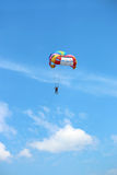 Parasailing on blue sky Royalty Free Stock Image