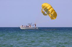 Parasailing in Blue Waters Stock Photos