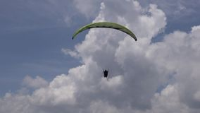 Parasailing in Clouds, Paragliding, Sky Diving stock video footage