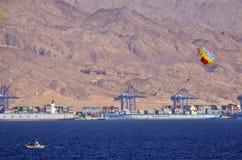 Parasailing in Eilat, Israel against port of Aqaba Jordan Stock Photo