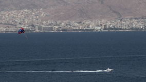 Parasailing in Eilat, Israel. EILAT, ISR - APRIL 14 2015: Parasailing in Eilat, Israel.Eilat, the resort city on the southernmost tip of Israel, offers great stock video