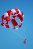 Parasailing Girls. Photo of a parasailing chute dragged by boat Stock Images