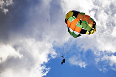 Parasailing in Hawaii. Couple soars among the clouds over Kaanapali Beach in Maui Royalty Free Stock Image