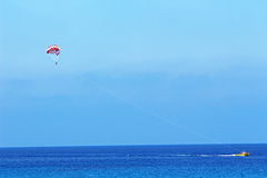 Parasailing at Konnos beach in Protaras Cyprus. Parasailing in Protaras Cyprus. Water sports provided at Konnos beach stock photography