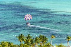 Parasailing in Miami, Florida. Miami, Florida - February 28, 2018:  An unidentified man prepares to get harnessed for a parasailing adventure in Miami, Florida royalty free stock photography
