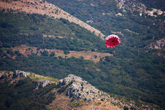 Parasailing. Mountain background Stock Photos