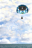Parasailing Oddity. Crazy looking picture of two people parasailing Royalty Free Stock Images