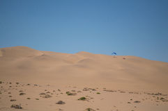 Parasailing off a Sand Dune near Swakopmund, Namibia Royalty Free Stock Photo
