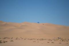 Parasailing off a Sand Dune near Swakopmund, Namibia Stock Photos