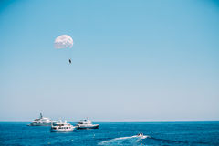 Parasailing in open sea. Water sports. Parasailing in open sea. Active water sports Royalty Free Stock Photo