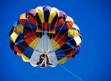 Parasailing over the blue sky Royalty Free Stock Images