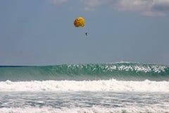 Parasailing over crashing waves Royalty Free Stock Images