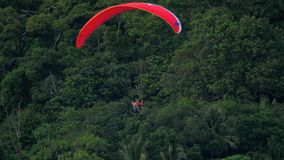 Parasailing over Nai Harn Beach, Phuket stock footage