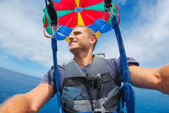 Parasailing Over Ocean in Hawaii Royalty Free Stock Photo