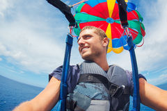 Parasailing Over Ocean in Hawaii Stock Photo