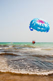 Parasailing over the sea. Parasailing with a boat over the sea Royalty Free Stock Photography