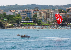 Parasailing over the sea beach. SOZOPOL - AUGUST 11: Parasailing over the sea beac  on August 11, 2015 in Sozopol, Bulgaria.  Parachute summer water; sport Royalty Free Stock Images