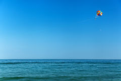 Parasailing over the seasea, sky, activity, blue, parachute, peo Royalty Free Stock Photos