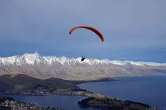 Paragliding above Queenstown New Zealand royalty free stock photos