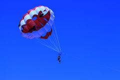 Parasailing Parachute in the sky. Parasailing Parachute in the blue sky Royalty Free Stock Image