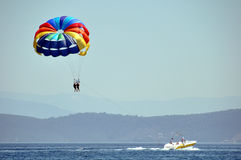Parasailing parachutte and boat Royalty Free Stock Photo