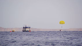 Parasailing, Parasailing Behind a Boat stock video footage