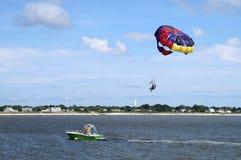 Parasailing. People para-sailing on a bright summer day along New Jersey shore Royalty Free Stock Photos