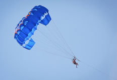 Parasailing. People parasailing on a sunny day Royalty Free Stock Photos