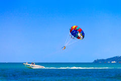Parasailing. Parasailing is a popular pastime in many resorts around the world. The active form of relaxation. Focus on a parachute Royalty Free Stock Photography