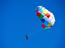 Parasailing popular vacation activity in summer resorts Stock Images
