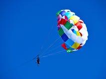 Parasailing popular vacation activity in summer resorts Royalty Free Stock Photo