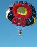 Parasailing at Punta Cana. Woman parasailing at Punta Cana in the Dominican Republic royalty free stock images