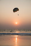 Parasailing silhouette at sunset Stock Photography
