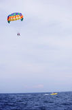 Parasailing in summer beach by speed boat, vertical composition Stock Images