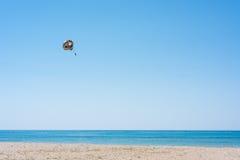 Parasailing summer sport. Parachute and boat Stock Photos