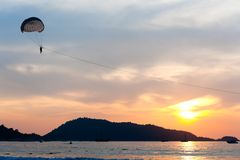 Parasailing at sunset Stock Photos