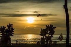 Parasailing at sunset at Patong beach, Phuket royalty free stock photography