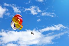 Parasailing - towed parachute against blue sky Royalty Free Stock Photo