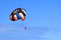 Parasailing under blue sky. Stock Photo