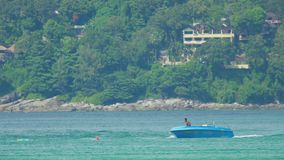 Parasailing, unsuccessful attempt, splashdown. PHUKET, THAILAND - NOVEMBER 19, 2015: A man and his parachute being removed from the water after splashdown stock video