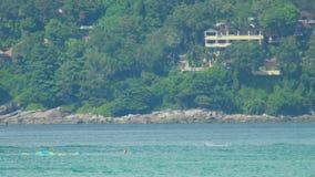 Parasailing, unsuccessful attempt, splashdown. PHUKET, THAILAND - NOVEMBER 19, 2015: The sudden splashdown during parasailing near Karon Beach, Phuket stock video footage