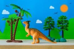 Parasaurolophus dinosaur toy model on wild models background. Closeup Stock Image