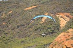 Parashoot flying along the coast Royalty Free Stock Image