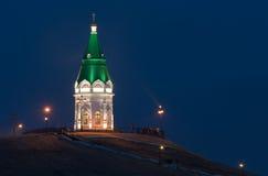 Paraskeva Pyatnitsa chapel, Krasnoyarsk. Old chapel on a mountain in Krasnoyarsk. the chapel is illuminated at night Royalty Free Stock Photography