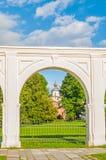 Paraskeva Pyatnitsa Church at Yaroslav Courtyard framed by white arch in Veliky Novgorod. Russia Royalty Free Stock Photos