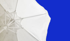 Parasol against the blue clear sky Stock Photo