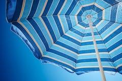 Parasol against deep blue sky Royalty Free Stock Photos