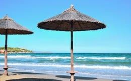 Parasols on the coast. Beach umbrellas at the beach Stock Photo